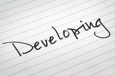A page with the word 'Developing' written down.