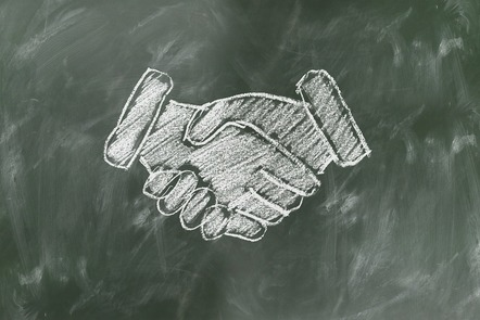 chalkboard drawing of shaking hands