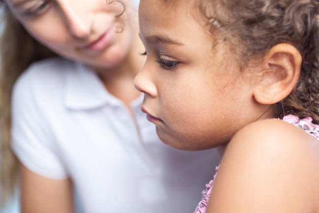 Woman talks with worried child