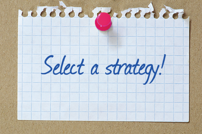 "A piece of paper pinned to a cork board with ""Select a strategy"" written on it."