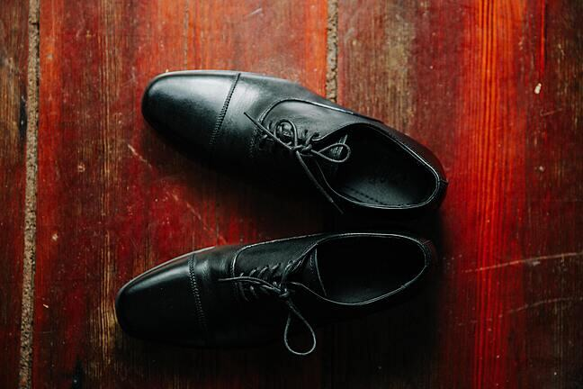 a pair of formal black lace-up men's shoes