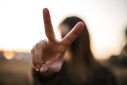 Woman with fingers in a peace or '2' sign Photo by Priscilla Du Preez on Unsplash