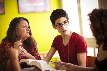 People talking in a classroom