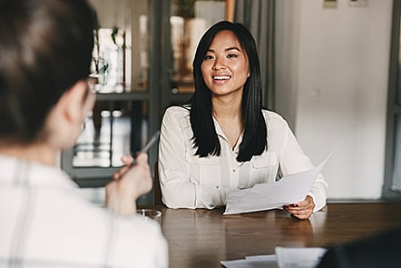 Recruiter interviewing a lady.