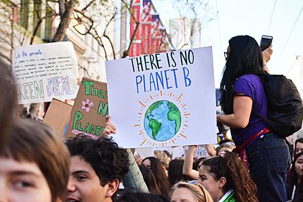 Protesters on a climate march holding sign saying 'there is no planet B'.