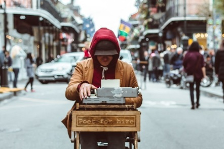 Poet sat at a typewriter in the street