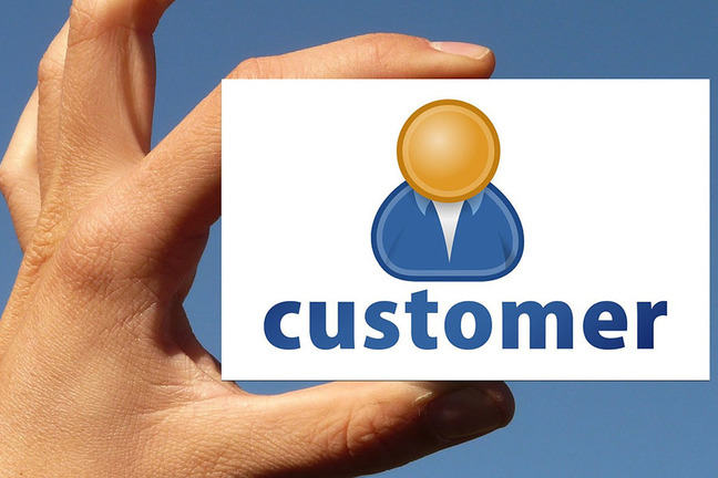 Hand holding card with the word customer