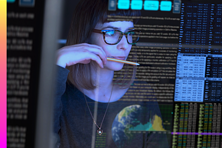 Woman looking through transparent screen overlayed with data and text