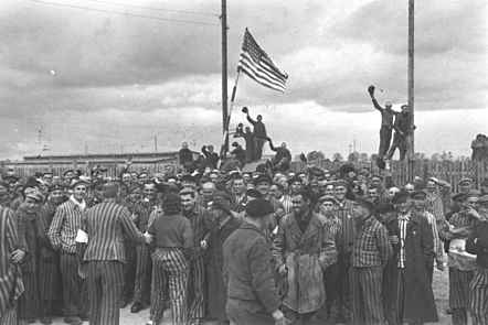 Prisoners of raise the American flag after the liberation, Dachau, Germany