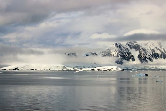 Ocean in Antarctica with snowy mountains in the back