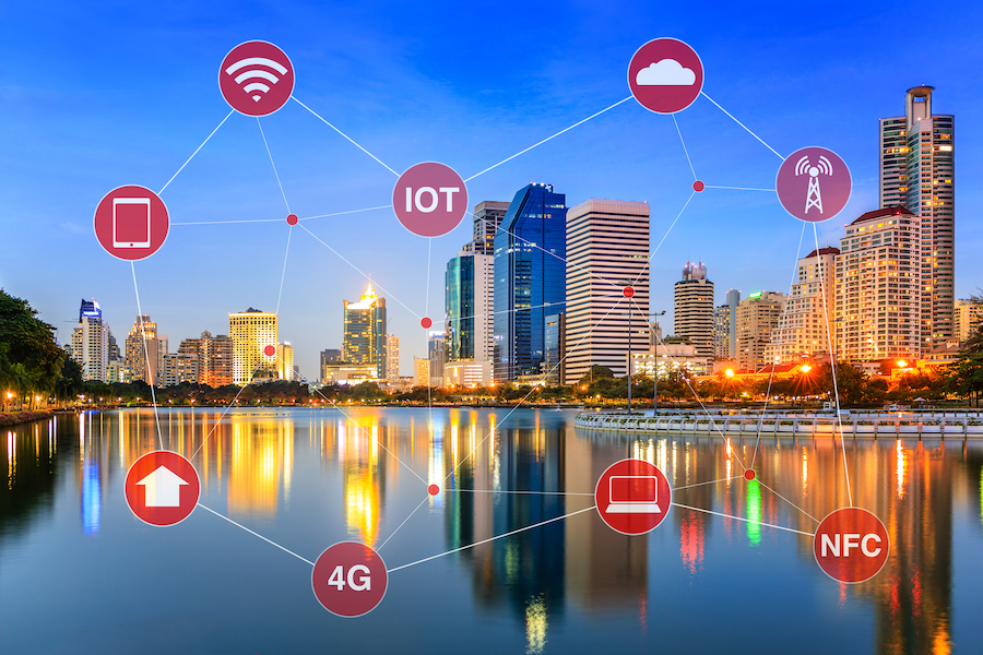 Icons floating above a cityscape representing connected services in a smart city
