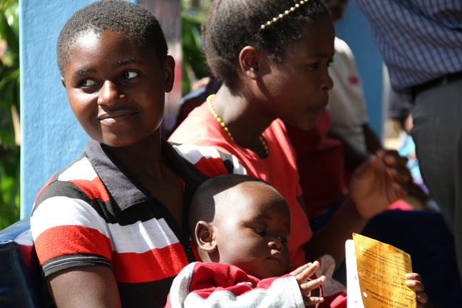 Image of mother and baby waiting for family planning services