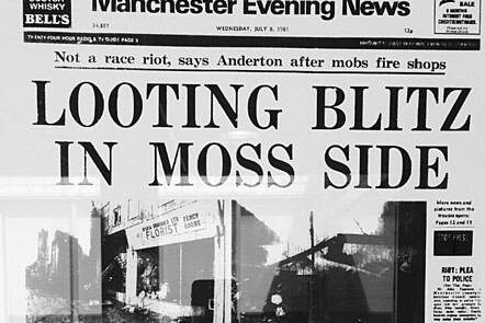 """A photograph of The Manchester Evening News headline """"Looting blitz in Moss Side"""""""