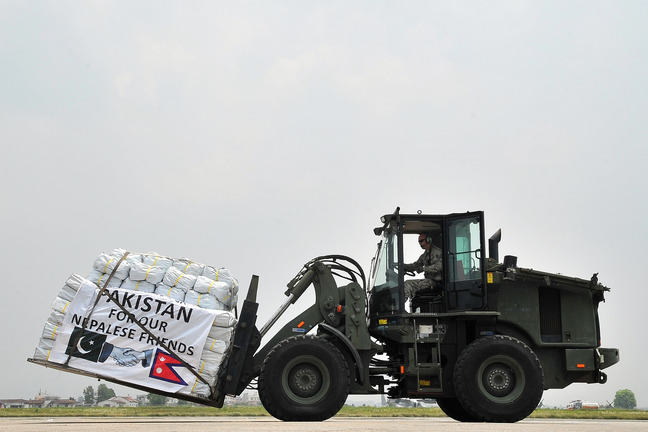 Image of relief supplies being delivered on tractor