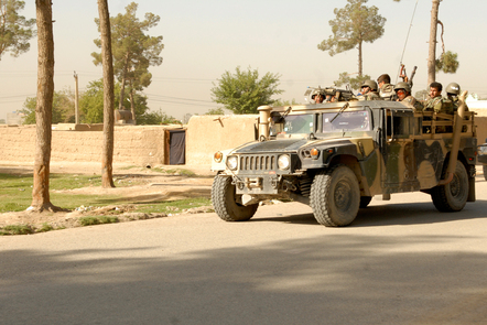 Afghan soldiers in a Humvee military vehicle.