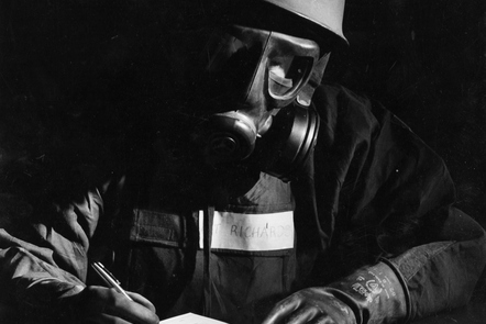 A serviceman working in a Nuclear, Biological, Chemical (NBC) suit.