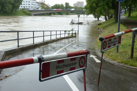 Image shows the impact of raising water levels including closed access to paths and damage to structures.