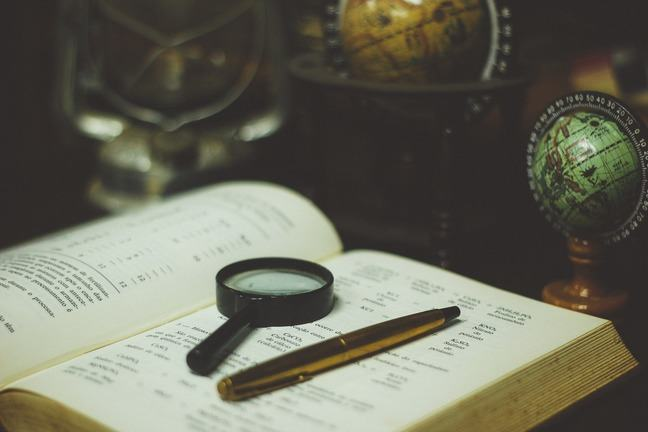 magnifying glass on top of a book