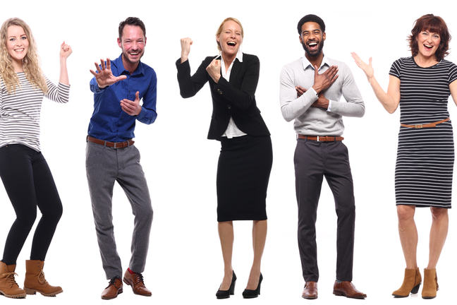 Five people with their arms up, looking happy